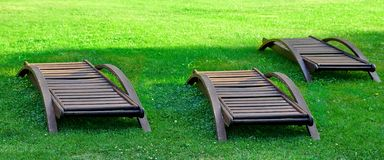Empty Wooden Weathered Lounger On The Lawn At The Evening Royalty Free Stock Photos