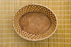 Empty wooden wicker plate basket on table Royalty Free Stock Photo