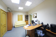Empty working area in office of company RUSELPROM Stock Photos