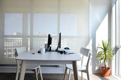 An empty working desk for two in home office. Working from home concept. Copy space Stock Photos