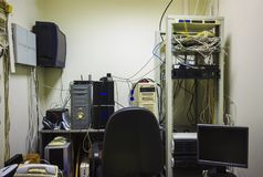 The empty workplace of the system administrator. The programmer develops software. Stock Image