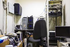 The empty workplace of the system administrator. The programmer develops software. Stock Images