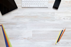 Empty workspace on wooden table Royalty Free Stock Photos