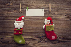 Empty xmas greeting card attached to clothespins between socks Stock Image