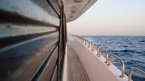 Empty yacht deck. With wooden floor of ship which float on sea at day stock footage
