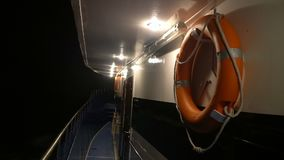 Empty yacht deck. With wooden floor of ship which float on sea at night stock video footage
