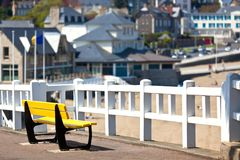 Empty yellow bench at coastline Royalty Free Stock Photography
