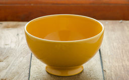 Empty yellow bowl Stock Photography