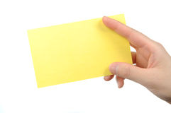 Empty yellow business card in a woman's hand Stock Photography