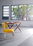 Empty yellow chair and table in minimalist loft Royalty Free Stock Photos