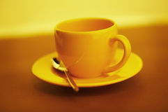 Empty yellow coffee cup Stock Images