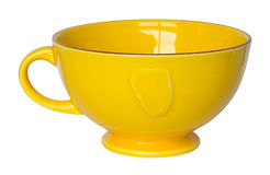Empty yellow cup isolated on white Stock Photo