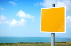 Empty Yellow Embellished Road Sign. Blank yellow Signpost with space for your own symbol or text Royalty Free Stock Images