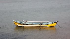 Empty yellow fishing boat anchored on water. A empty yellow fishing boat anchored on water stock video