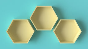 Empty yellow hexagons shelves on blue concrete wall background Royalty Free Stock Photo
