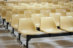 Empty yellow plastic chairs Royalty Free Stock Photography