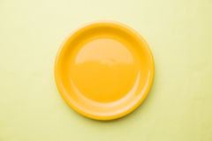 Empty yellow plate Royalty Free Stock Photos