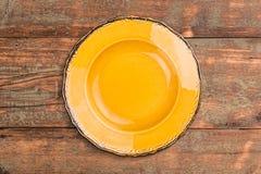 Empty yellow plate Stock Photo