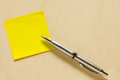 Empty Yellow Post it with Ballpen Stock Image