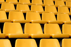Empty yellow seats. In a pabillion Stock Images