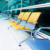Empty yellow seats at the airport Stock Photo
