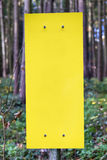 Empty yellow sign in forest Royalty Free Stock Image
