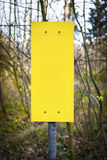 Empty yellow sign in forest Stock Photo