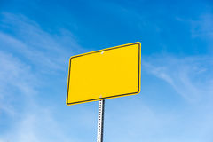 Empty yellow sign over a blue sky with copyspace Royalty Free Stock Photo