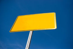 Empty yellow sign over a blue sky with copyspace Royalty Free Stock Image