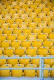 Empty, yellow stadium seats Stock Photos