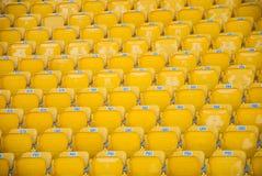 Empty, yellow stadium seats Royalty Free Stock Images
