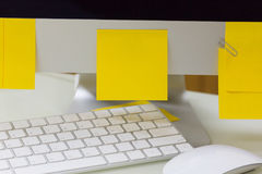 Empty yellow sticky note on computer. Stock Images