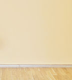 Empty yellow wall and wooden floor room Royalty Free Stock Photos