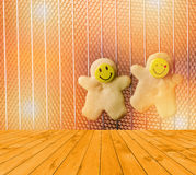 Empty yellow wooden deck table with Christmas cookies, shortbread with smiling faces in hot oven. Ready for product display montag Stock Photos