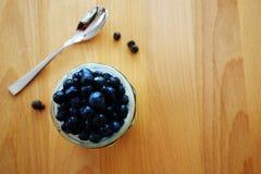 Empty yogurt jar with a spoon stock image