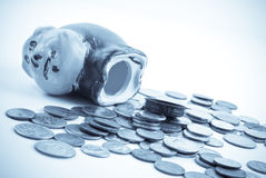 Emptying Out the Piggy Bank Stock Photography