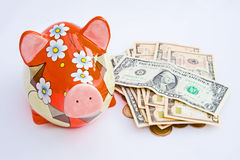 Emptying a piggy bank for holiday money. Stock Images