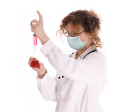 Emptying syringe female doctor in medical mask Stock Photography