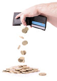 Emptying wallet. Wallet emptying pound coins isolated on white Stock Photos