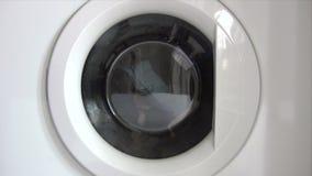 Emptying Washing Machine Stock Image