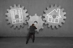 Empujando el engranaje concreto para conectar a casa y oficina Fotografía de archivo