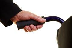 Empujar el sillón de ruedas manualmente Fotografía de archivo libre de regalías