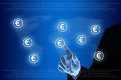Empujar la red euro de la moneda manualmente Imágenes de archivo libres de regalías