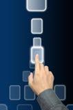 Empujar un botón manualmente en interfaz de la pantalla táctil foto de archivo libre de regalías