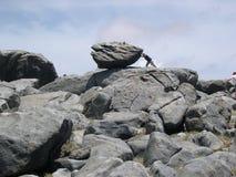 Empuje la roca Imágenes de archivo libres de regalías