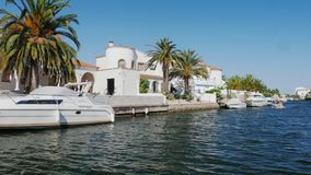 EMPURIABRAVA, SPAIN - JUNE 20, 2016: Channels, luxury real estate, houses and yachts. One of the biggest residences near