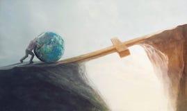 Empurrando o mundo sobre a cruz Fotos de Stock Royalty Free
