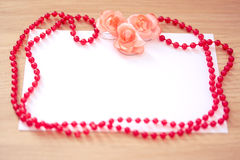 Empy card for your text with necklace and flowers Stock Image