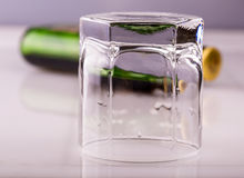 Empy Glass without whiskey and empty bottle on the bar Stock Photo
