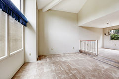 Empy house interior with high vaulted ceiling and carpet floor Stock Photo